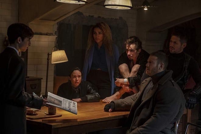 "Aidan Gallagher, Ellen Page, Emmy Raver-Lampman, Robert Sheehan, Tom Hopper and David Castañeda in ""The Umbrella Academy."""