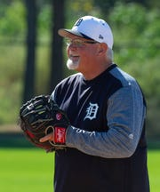 Ron Gardenhire laughs as his pitchers take fielding drills during spring training practice on Thursday.