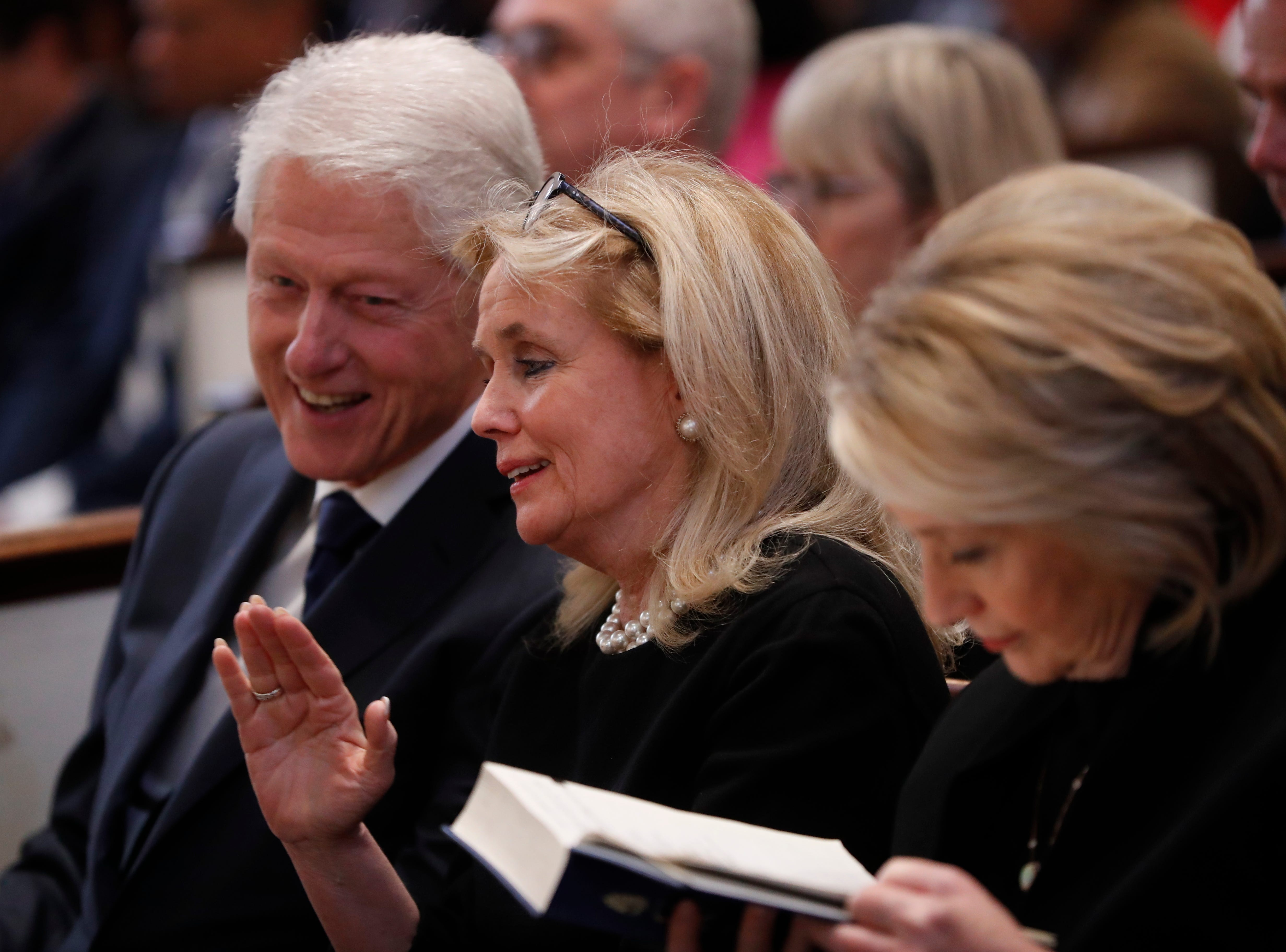 Rep. Debbie Dingell, D-Dearborn, center, talks with former President Bill Clinton and former Secretary of State Hillary Clinton during the funeral for her husband, former Rep. John Dingell, Thursday, Feb. 14, 2019 at Holy Trinity Catholic Church in Washington.