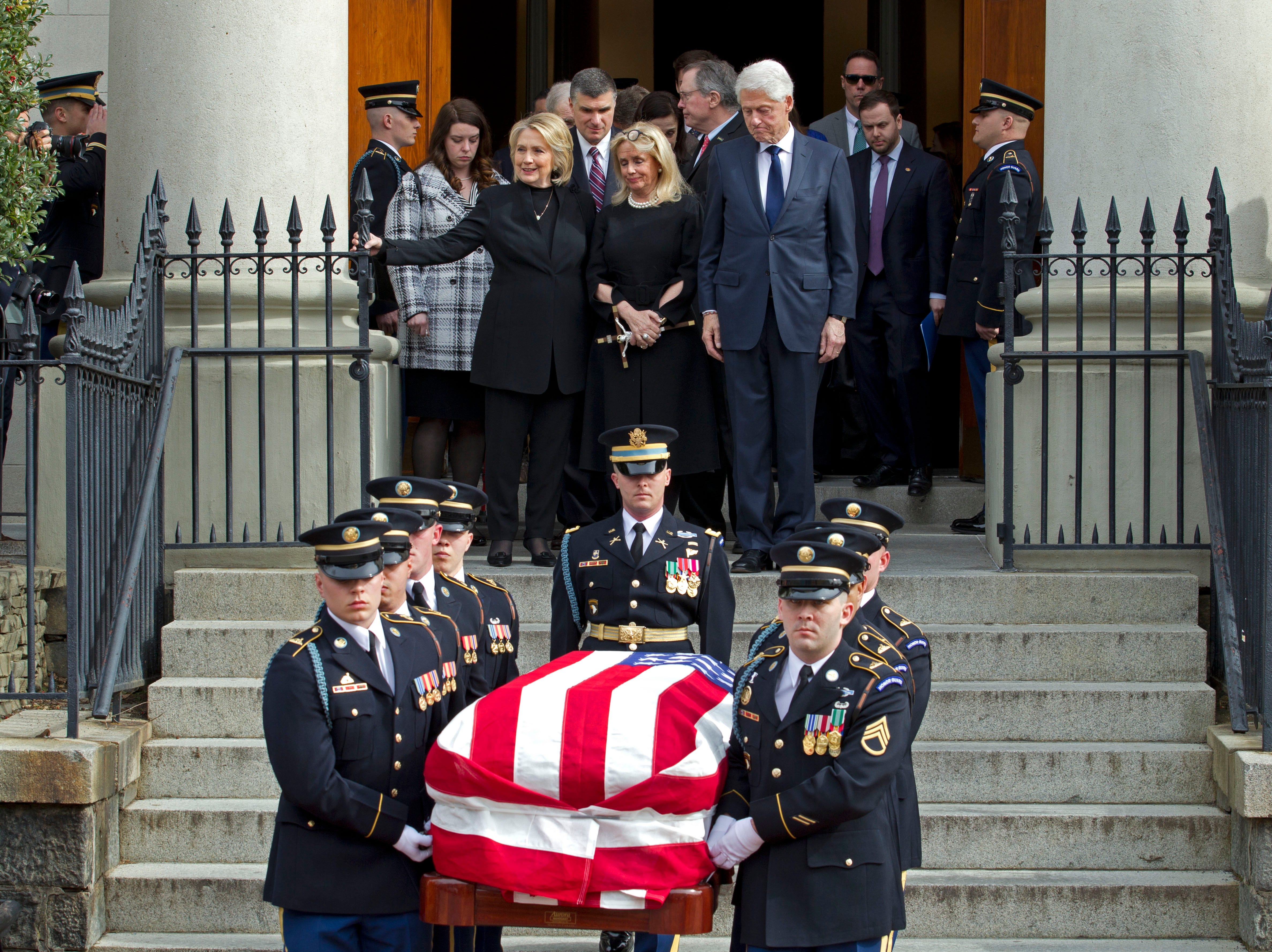 Rep. Debbie Dingell, D-Dearborn, center, accompanied by former President Bill Clinton and former first lady Hillary Clinton, follows the flag-draped casket of former Rep. John Dingell after the funeral at Holy Trinity Catholic Church, Thursday, Feb. 14, 2019, in Washington. Dingell, the longest-serving member of Congress in American history who mastered legislative deal-making and was fiercely protective of Detroit's auto industry, died at age 92.