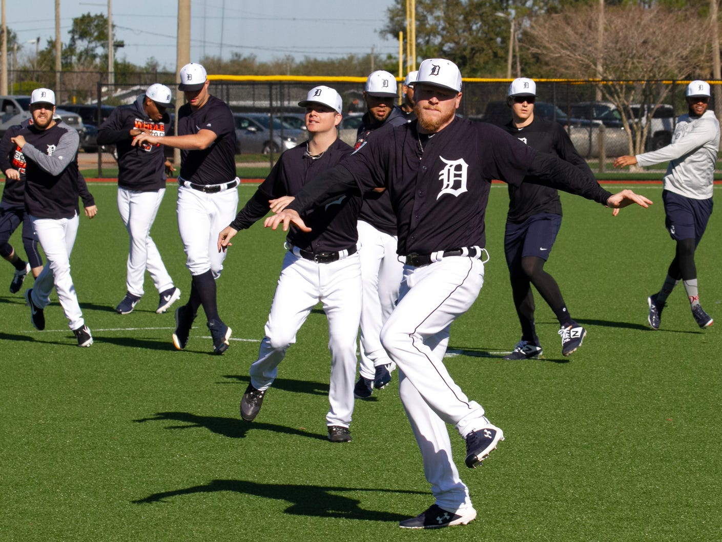 Detroit Tigers pitchers including Daniel Stumpf, center, and catchers warm up during spring training practice.