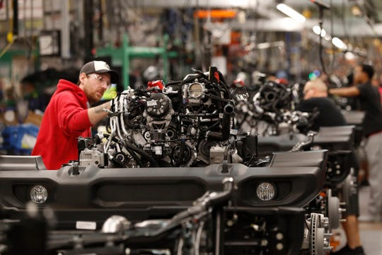An assemblyman works on the engine and chassis of the 2019 Jeep Wrangler at the Toledo North Assembly Plant, Friday, Nov. 16, 2018, in Toledo, Oh.