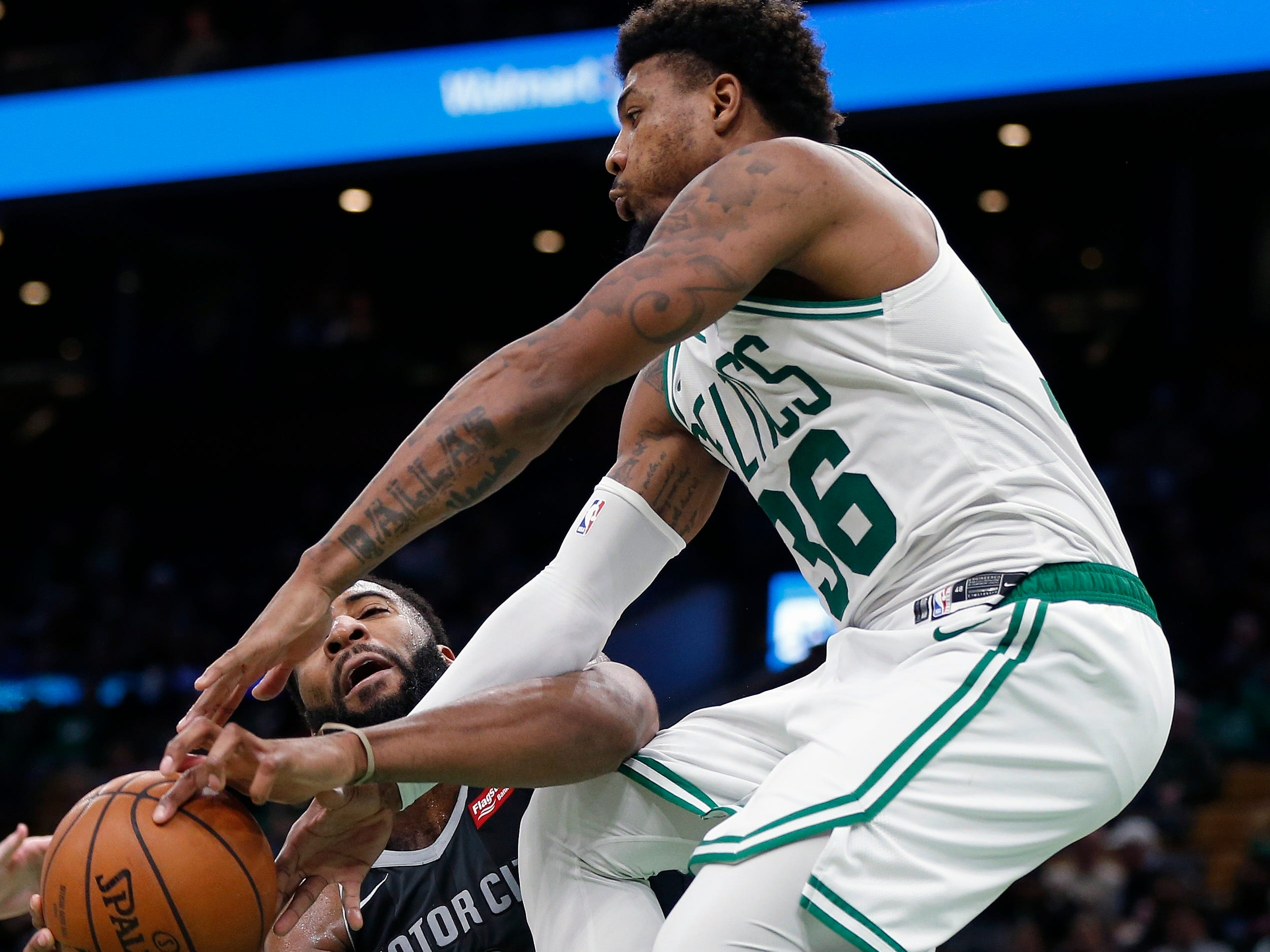 Boston Celtics' Marcus Smart (36) and Detroit Pistons' Andre Drummond (0) battle for a rebound during the second half.