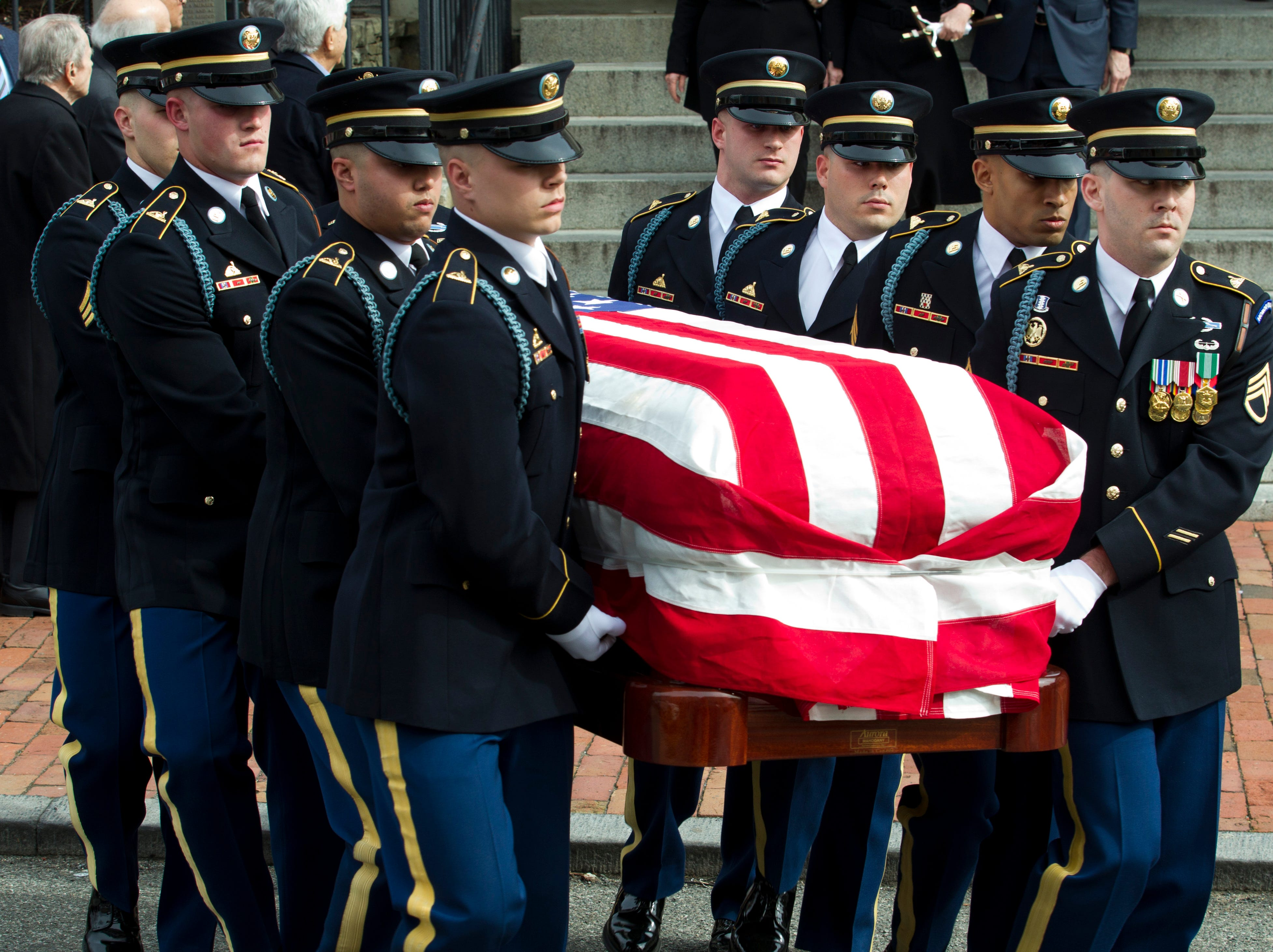 The flag-draped casket of former Rep. John Dingell departs the church after the funeral at Holy Trinity Catholic Church, Thursday, Feb. 14, 2019, in Washington.
