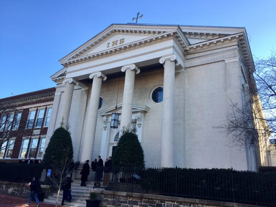 Mourners line up outside the Washington D.C. funeral service for former Congressman John Dingell in Georgetown.
