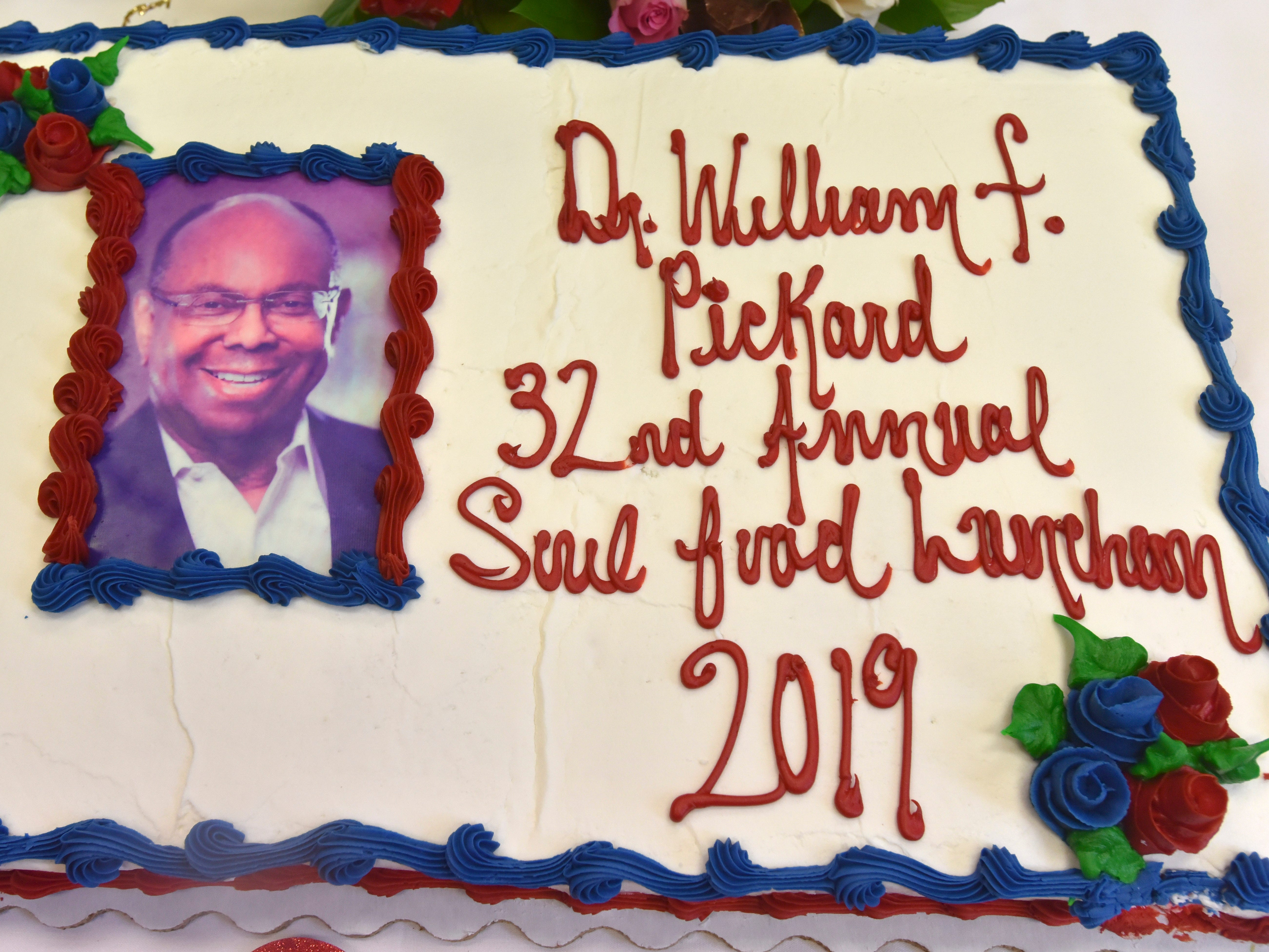 A portrait of William F. Pickard, Soul and Spirit Humanitarian Award honoree, adorns a cake in Judge Damon Keith's chambers.