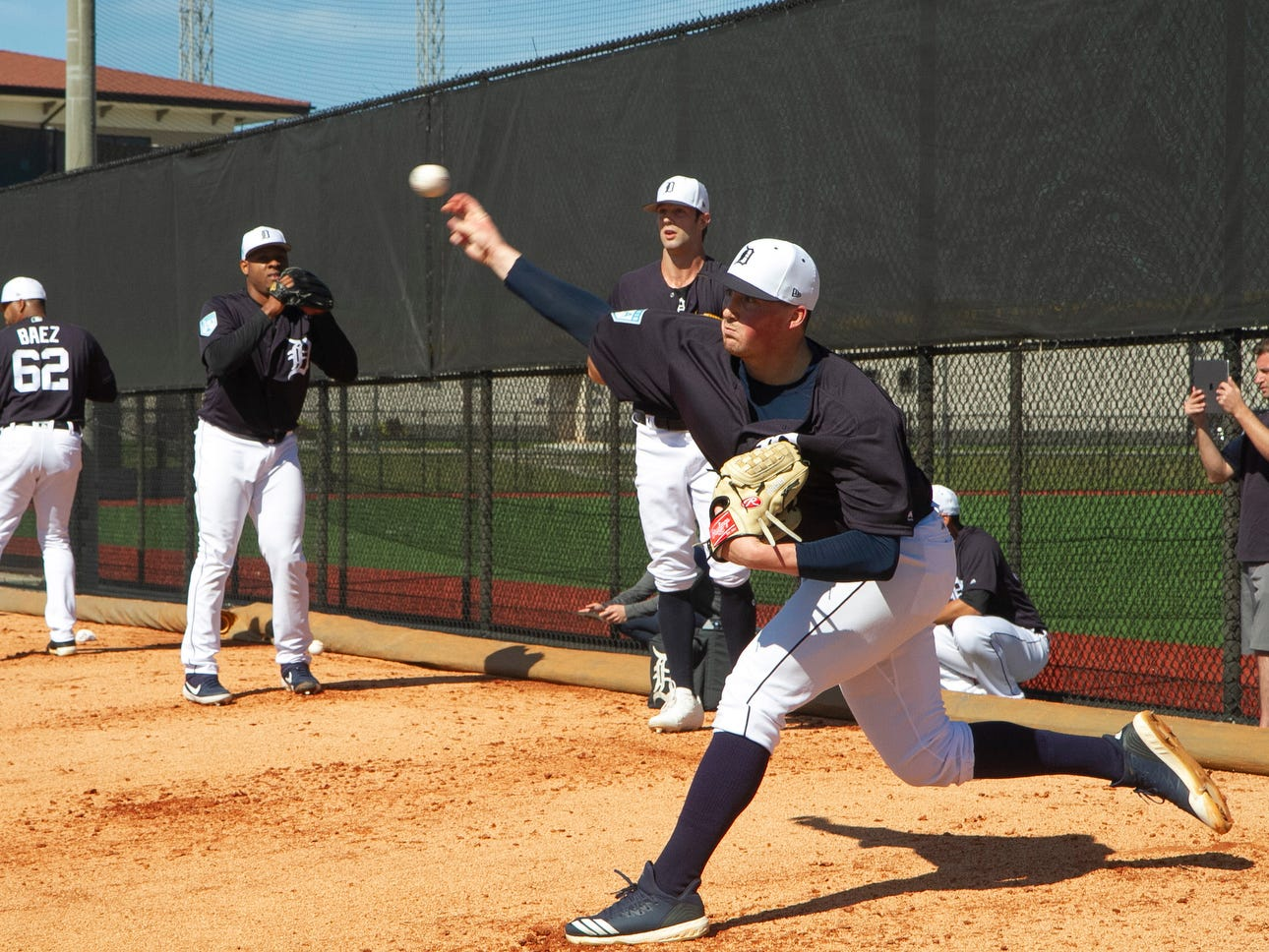 Detroit Tigers pitcher Kyle Funkhouser, right, throws pitches a bullpen session.