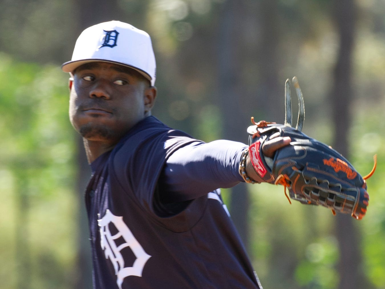 Detroit Tigers pitcher Victor Alcantara eyes the plate as he takes fielding drills.