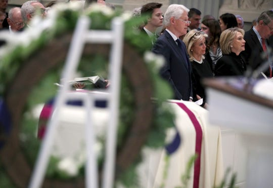 Former President Bill Clinton, Rep. Debbie Dingell, D-Mich., and former Secretary of State Hilary Clinton, attend the funeral for former Rep. John Dingell, D-Mich., at Holy Trinity Church, Thursday, Feb. 14, 2019 in Washington.