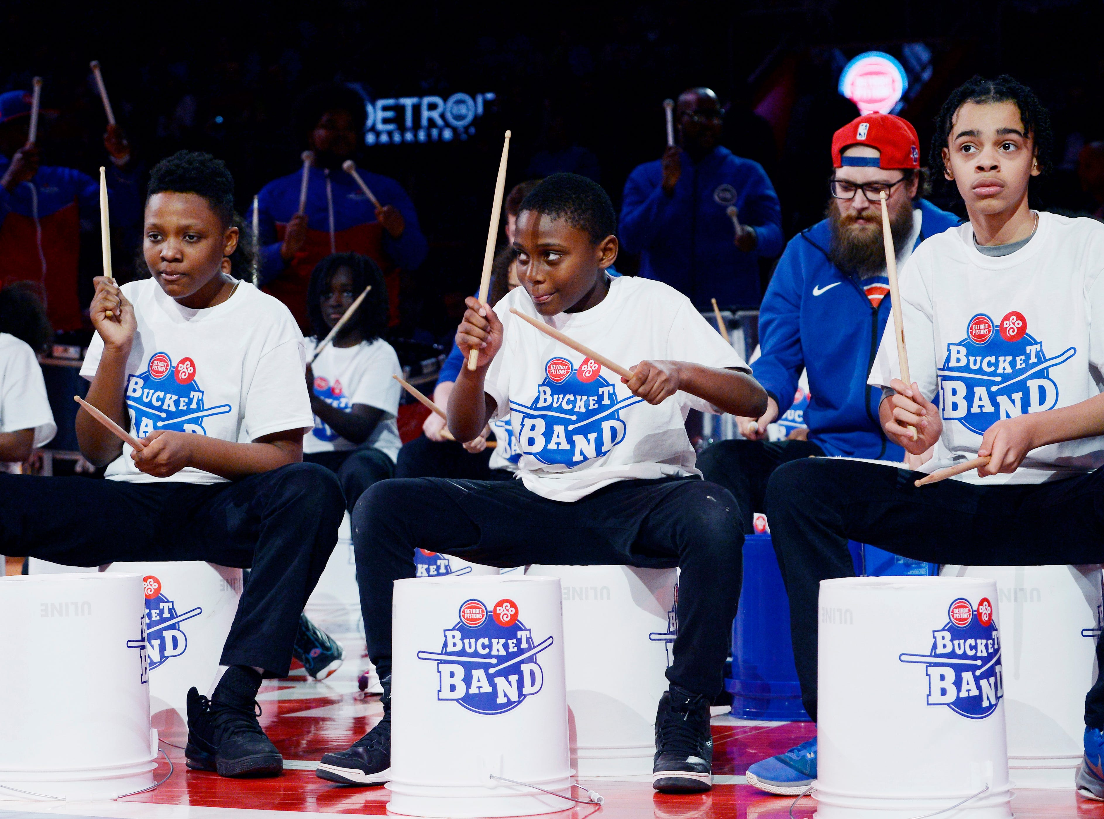 Detroit Symphony Orchestra Bucket Band members performs during a timeout in the second quarter.