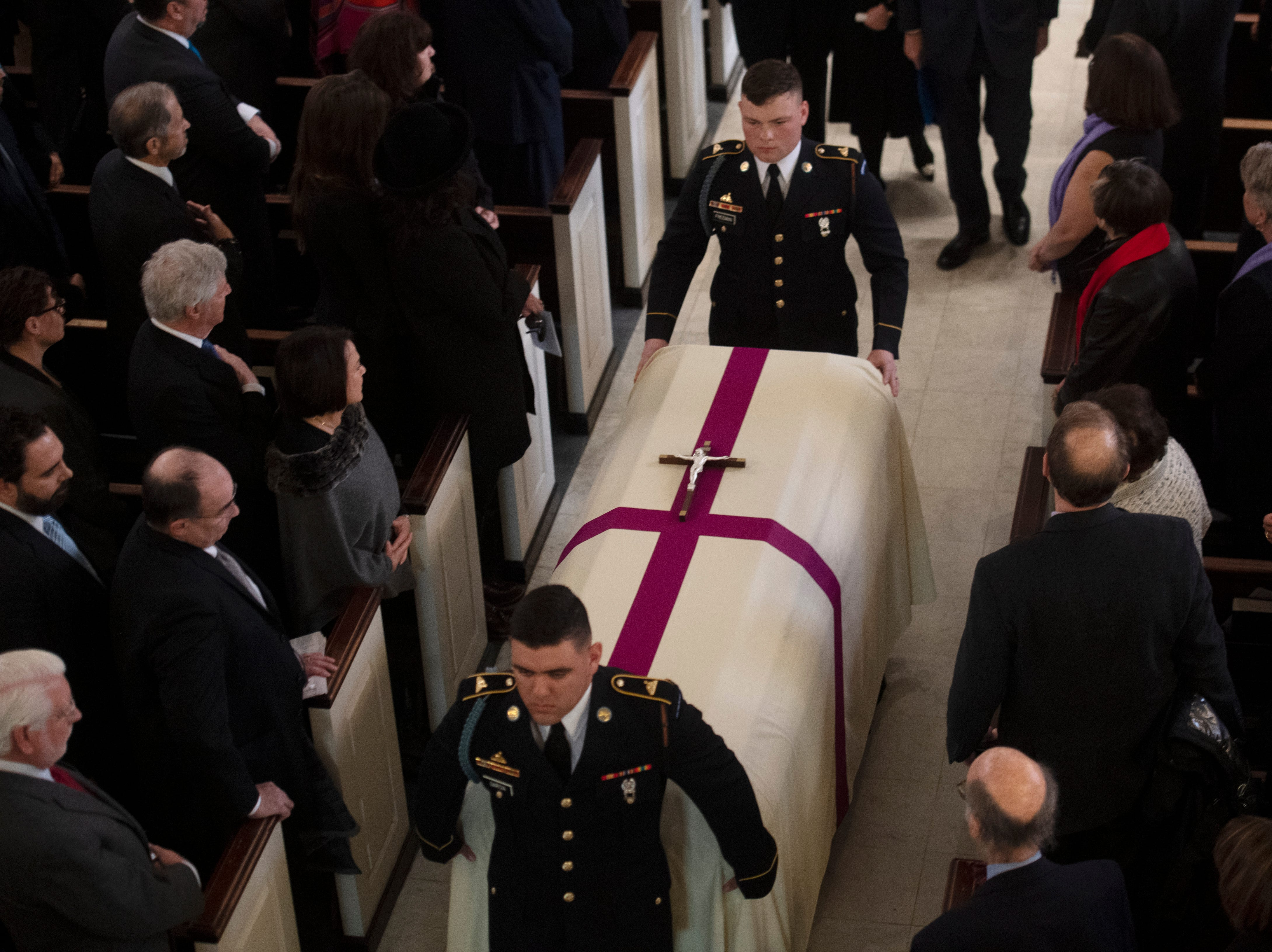 The casket of former Rep. John Dingell, D-Dearborn, departs the church at the conclusion of his funeral.
