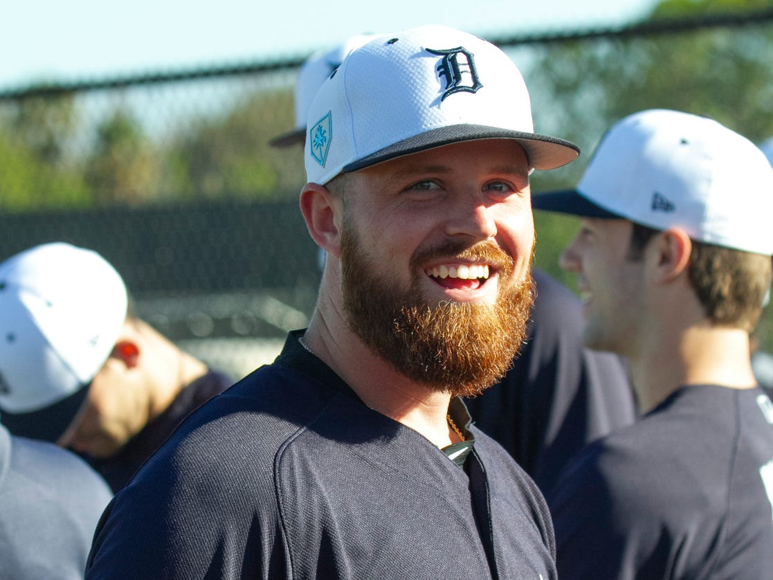 Detroit Tigers pitcher Buck Farmer smiles prior to the start of spring training practice for pitchers and catchers.