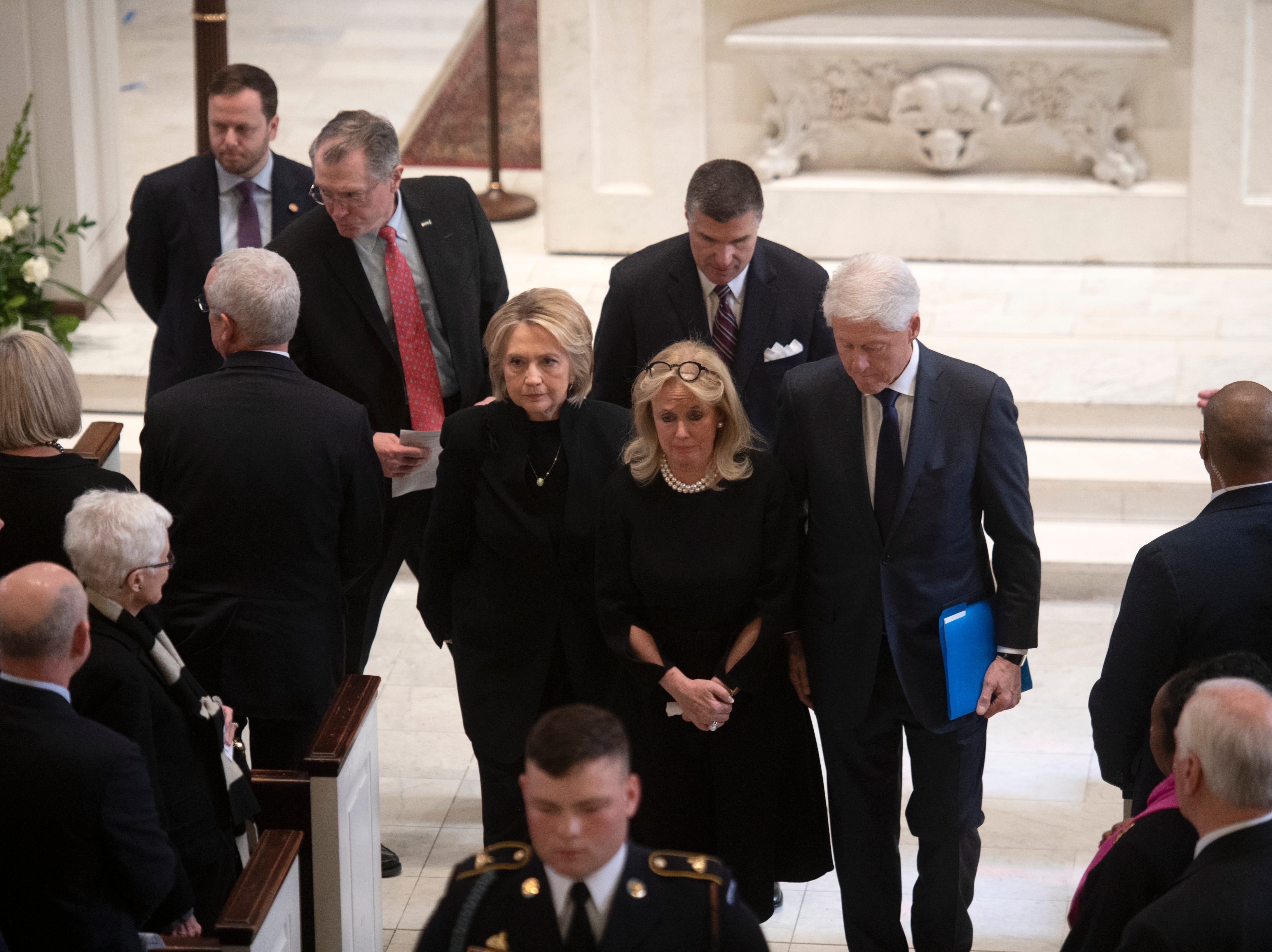 Rep. Debbie Dingell, D-Dearborn, departs the church with former President Bill Clinton and former Secretary of State Hillary Clinton at the conclusion of the funeral for her husband, former Rep. John Dingell.