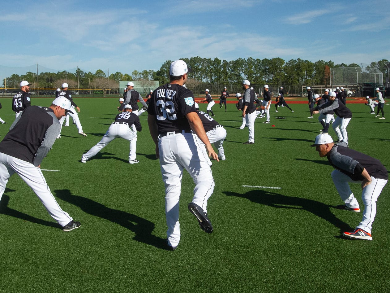 Detroit Tigers pitchers including Michael Fulmer, center, and catchers stretch during spring training practice.