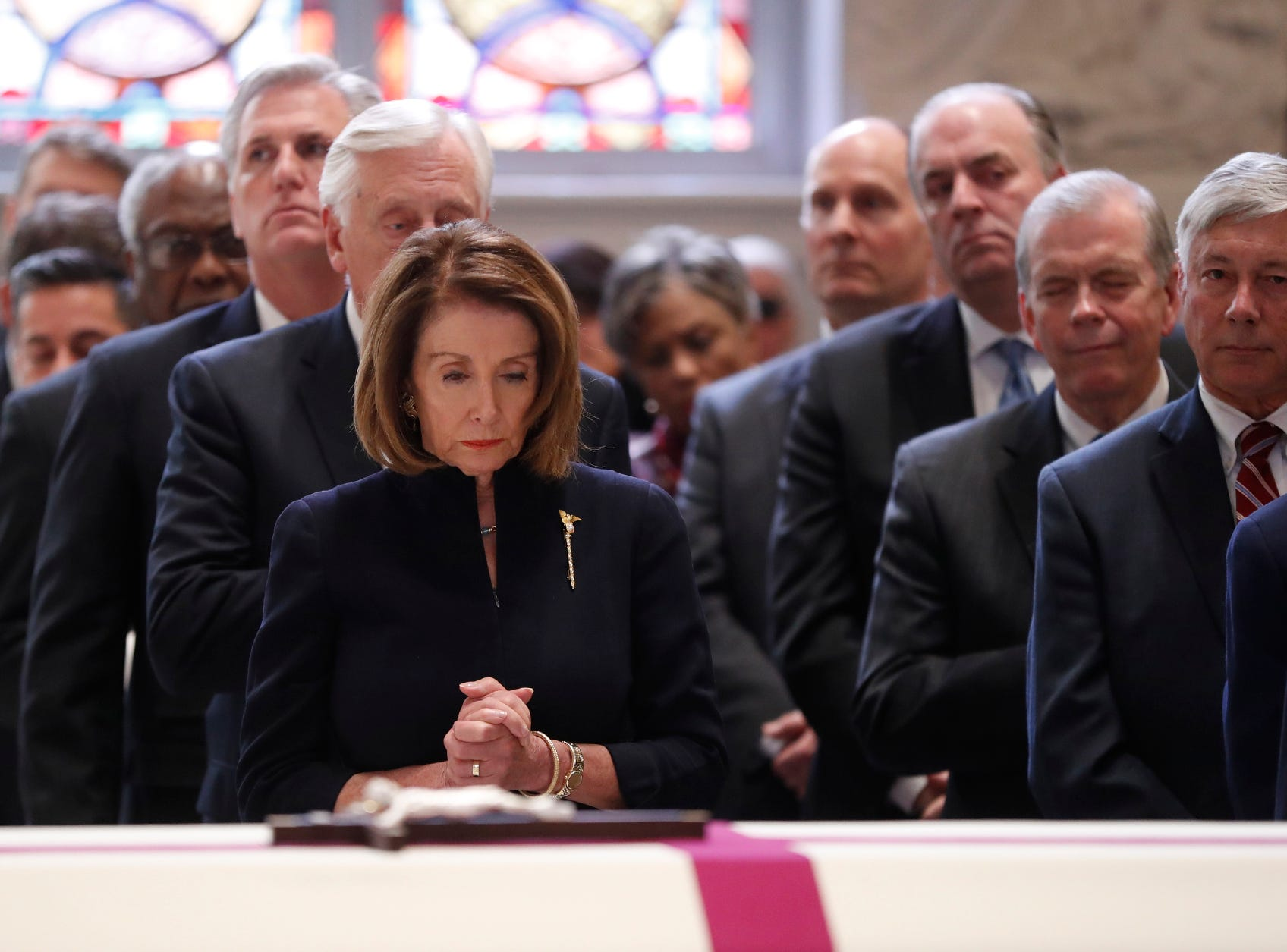 House Speaker Nancy Pelosi stands during the funeral for former Rep. John Dingell, D-Dearborn.