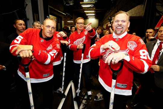 Larry Murphy, center, is pictured with Darren McCarty, left, and Tomas Holmstrom during the final game at Joe Louis Arena on April 9, 2017.