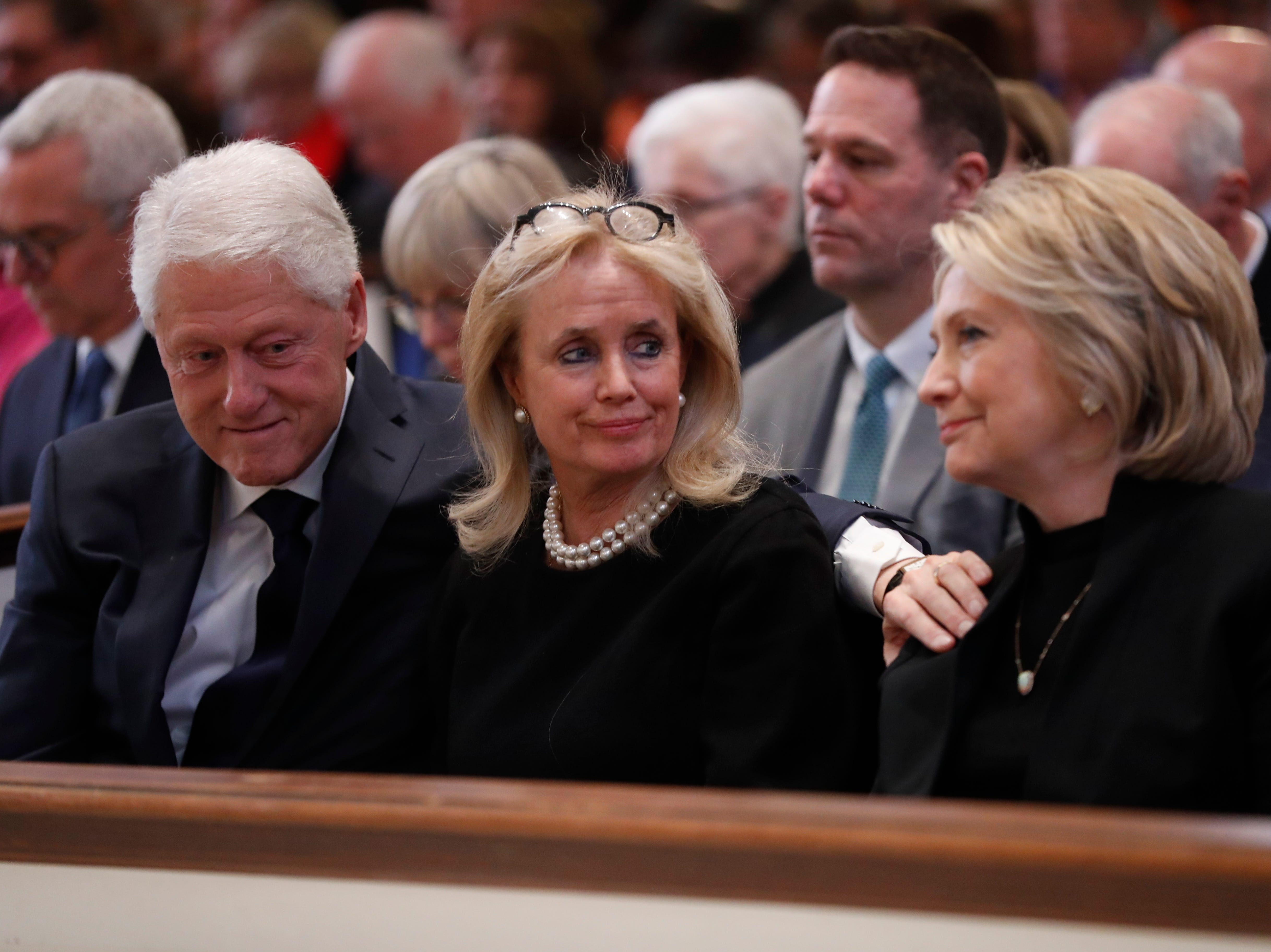 Rep. Debbie Dingell, D-Dearborn, center, talks with former President Bill Clinton and former Secretary of State Hillary Clinton during the funeral for her husband, former Rep. John Dingell, Thursday, Feb. 14, 2019 at Holy Trinity Catholic Church in Washington. Dingell, who represented southeast Michigan for 59 years in the House of Representatives, died last week at age 92.