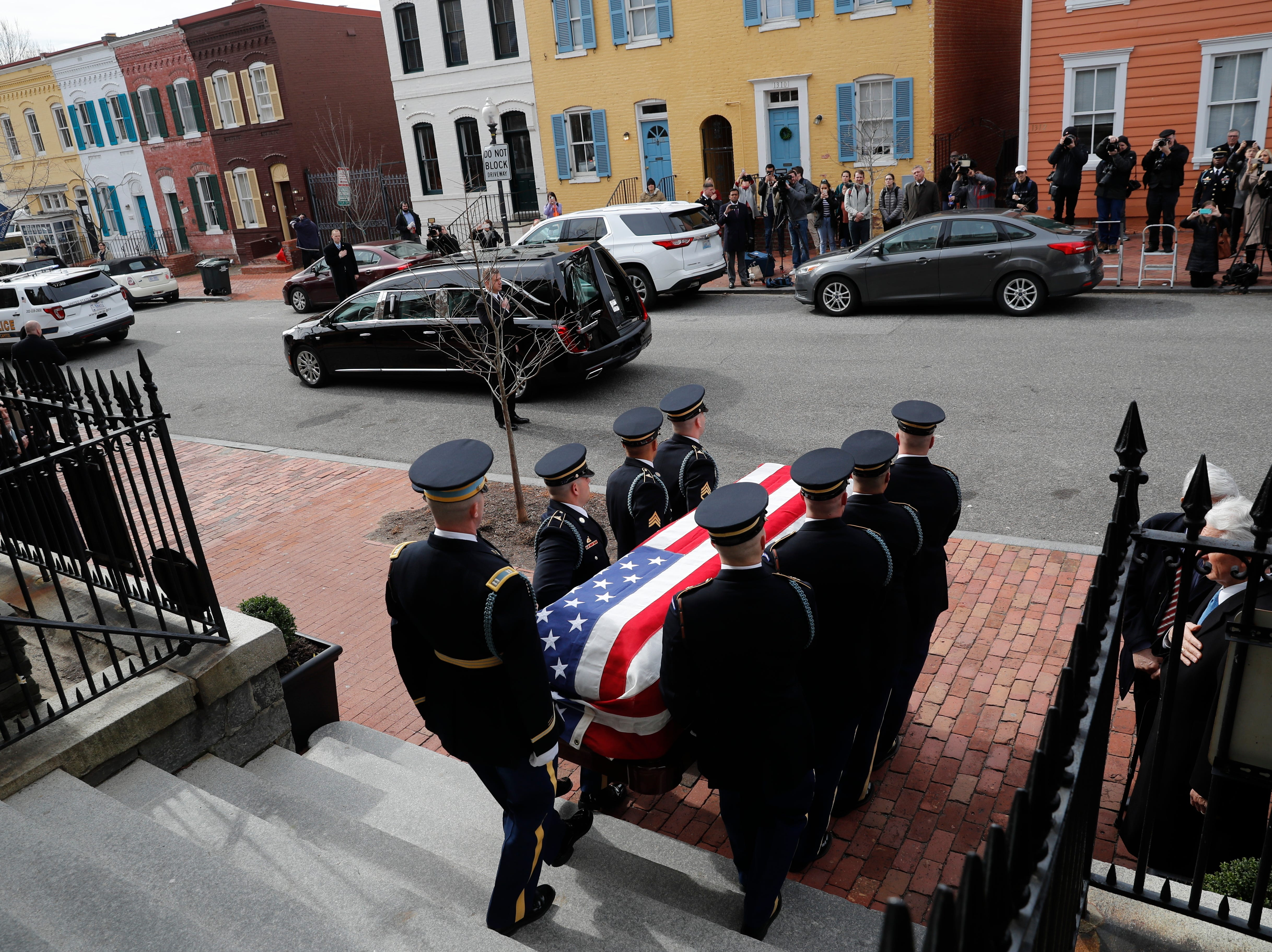 The flag-draped casket of former Rep. John Dingell, D-Dearborn, departs the Holy Trinity Catholic Church, after his funeral, Thursday, Feb. 14, 2019, in Washington.