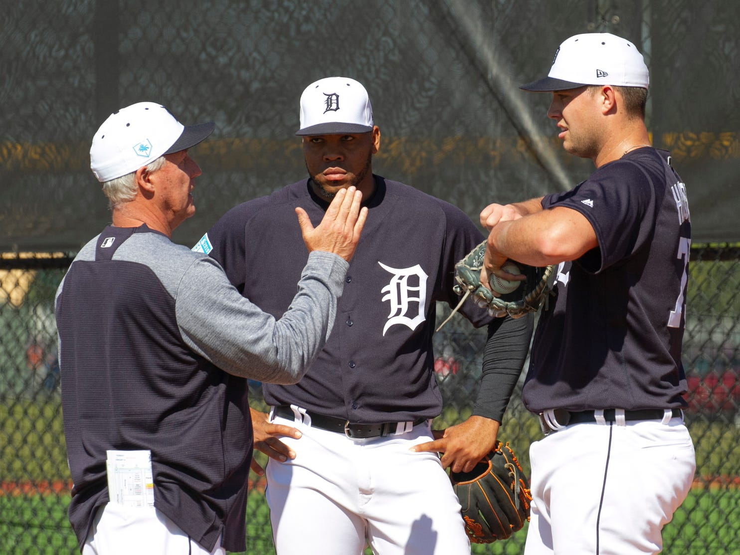 Detroit Tigers pitching coach Rick Anderson, left, speaks with pitchers Sandy Baez, center, and Zac Houston after their bullpen session.