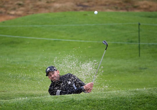 Sergio Garcia, of Spain, hits out of the bunker on the ninth green during the pro-am round of the Genesis Open.