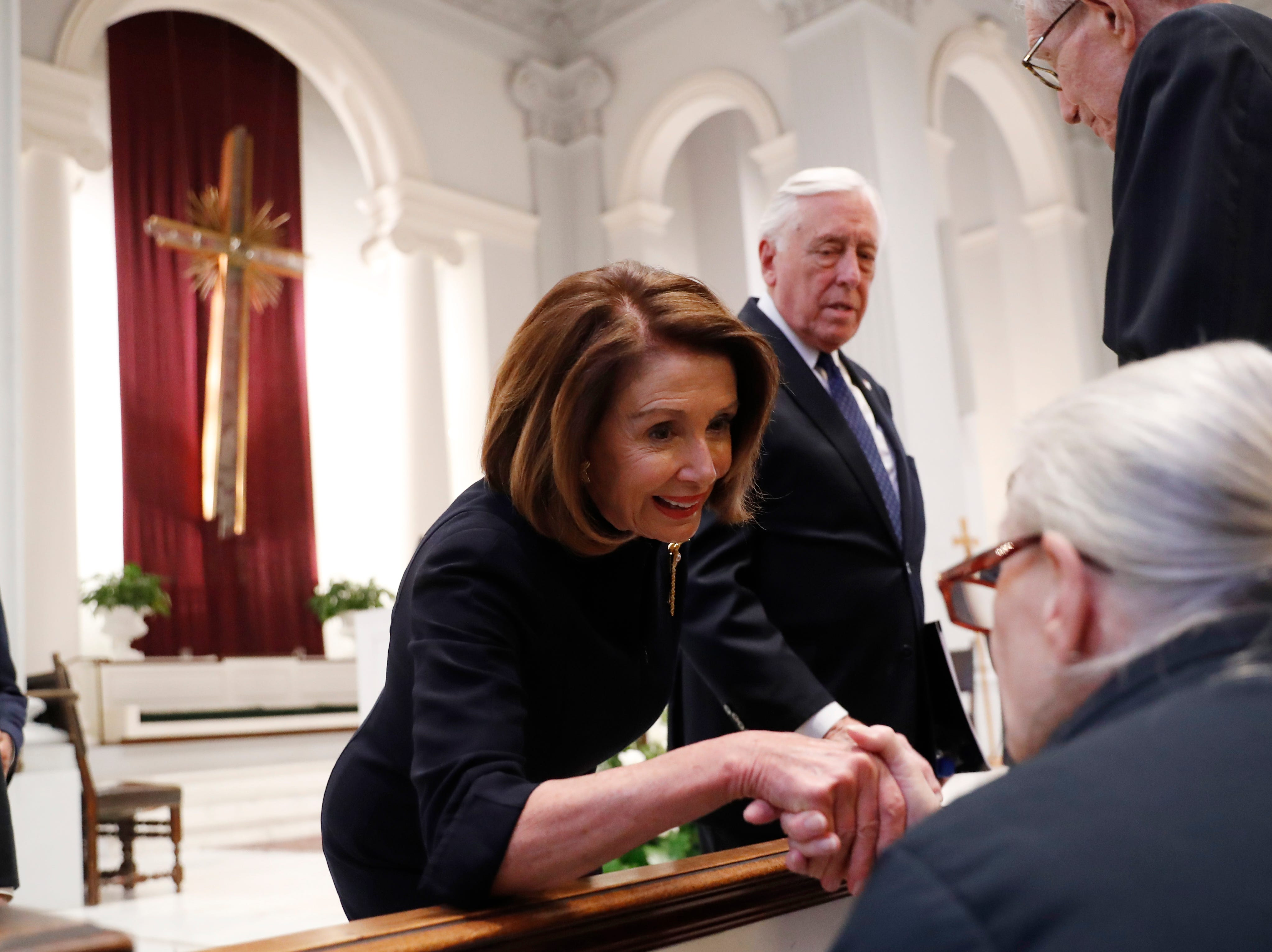 House Speaker Nancy Pelosi and Rep. Steny Hoyer, D-Md., greet family members before a funeral for former Rep. John Dingell, Thursday, Feb. 14, 2019 at Holy Trinity Catholic Church in Washington.