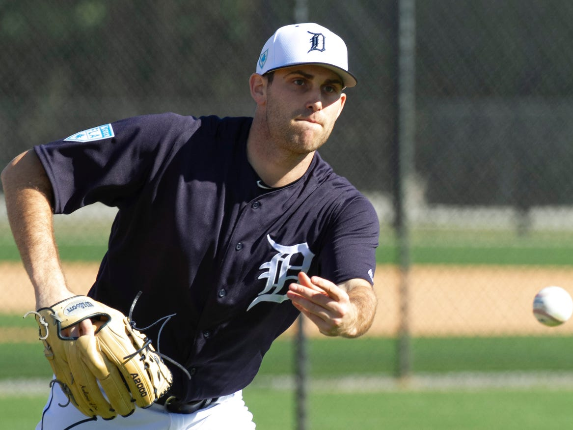 Detroit Tigers pitcher Matthew Boyd throws to first base as he takes fielding drills.
