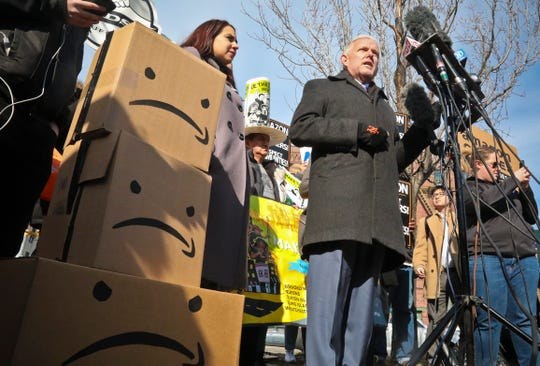 New York City Councilman Jimmy Van Bramer, center, speaks during a conference in Gordon Triangle Park in the Queens borough of New York, following Amazon's announcement it would abandon its proposed headquarters for the area, Thursday Feb. 14, 2019.