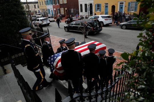 The flag-draped casket of former Rep. John Dingell, D-Mich., departs the Holy Trinity Catholic Church, after a funeral service, Thursday, Feb. 14, 2019, in Washington.