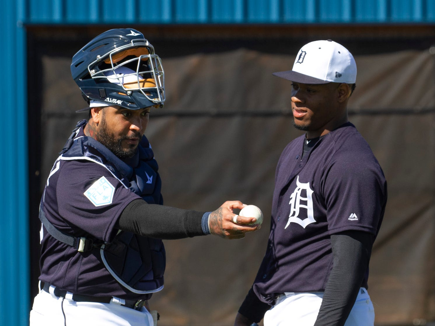 Detroit Tigers catcher Hector Sanchez, left, and pitcher Gregory Soto talk after Sanchez caught for Soto in a bullpen session.