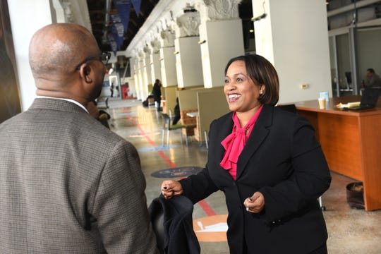Darienne Driver, right, CEO of United Way for Southeastern Michigan, speaks with Samino Scott at their downtown Detroit offices on Thursday.