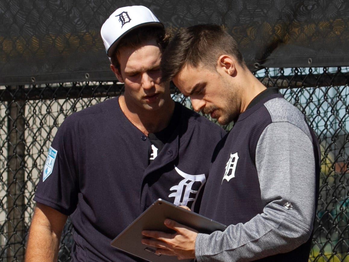 Detroit Tigers pitcher Daniel Norris, left, and analyst Zach Wolf watch video analytics of Norris throwing after a pitch session.