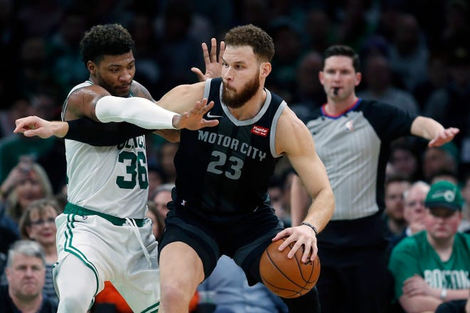 Boston Celtics' Marcus Smart (36) defends against Detroit Pistons' Blake Griffin (23) during the first half.