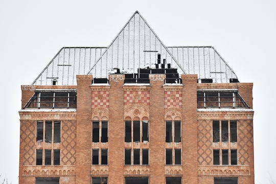 Missing portions of the roof can be seen on the Lee Plaza building in this file photo from Dec. 11, 2017.
