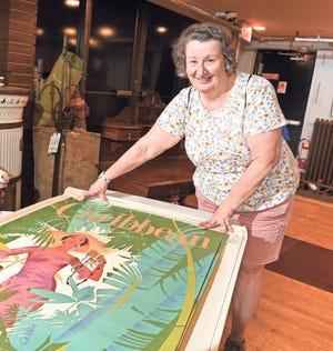 Helen Huseltine with her Pan Am posters DuMochelles Art Galleries,