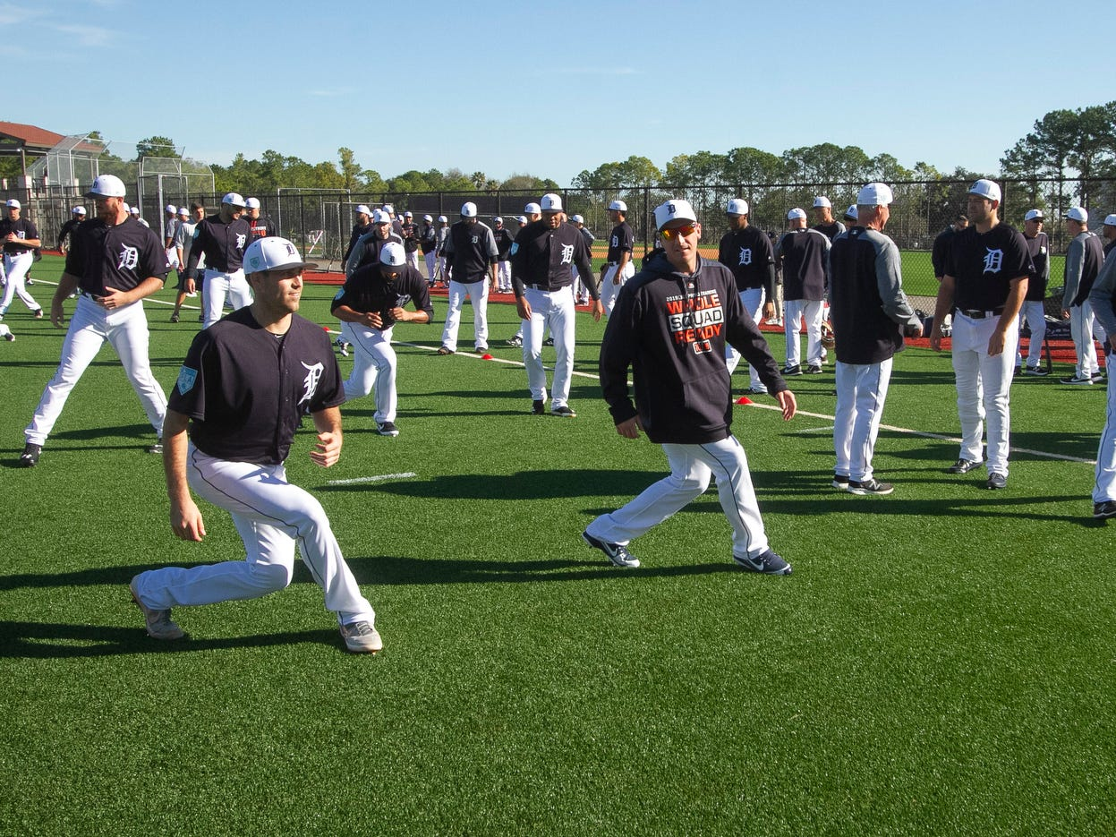 Detroit Tigers pitchers and catchers stretch during spring training practice.