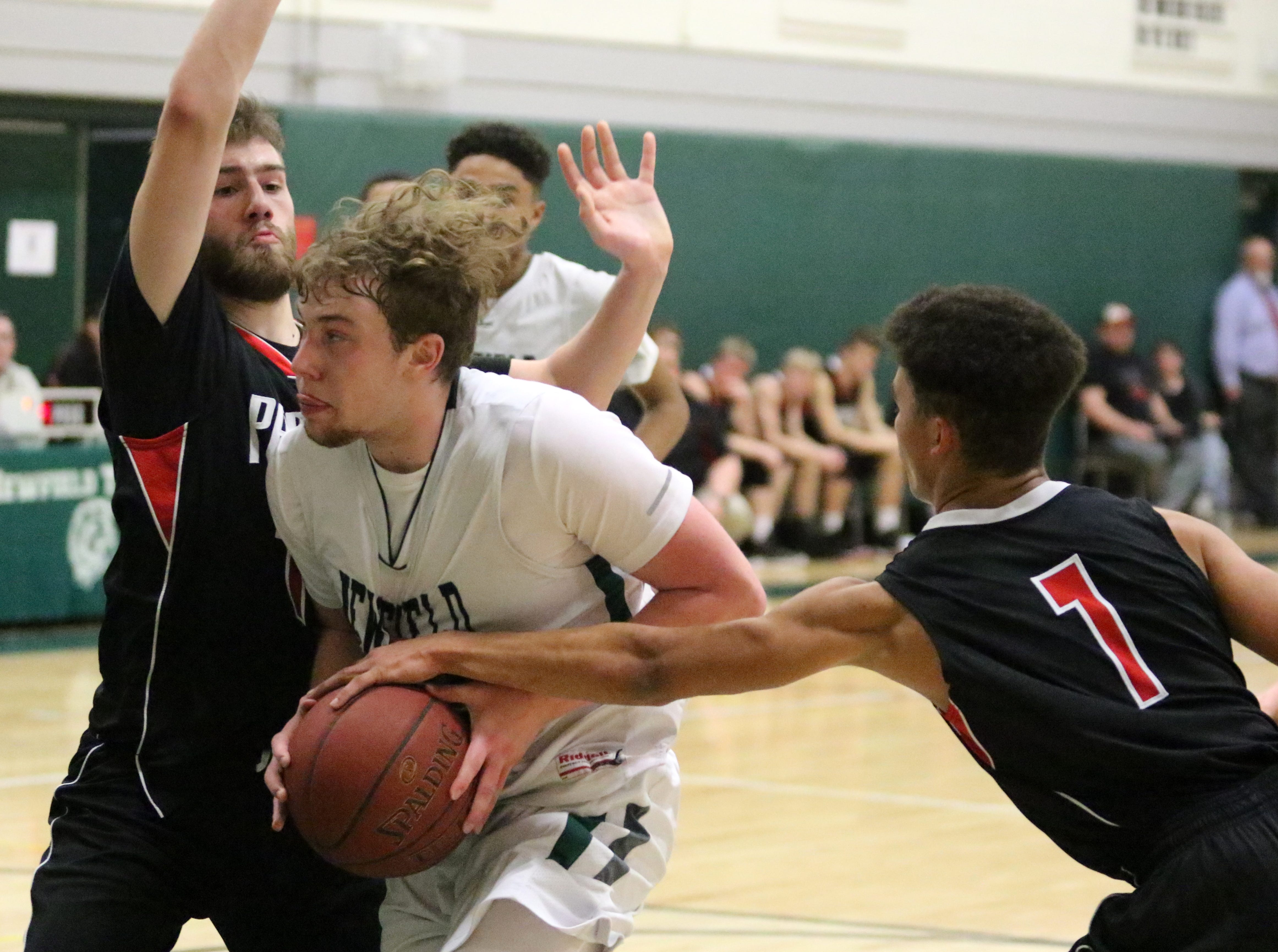 Action from the Newfield boys basketball team's 66-52 home win over Spencer-Van Etten in an IAC South Small School boys basketball tiebreaker Feb. 13, 2019.
