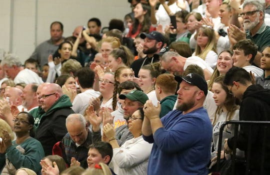 Newfield fans cheer their team after the Trojans beat Spencer-Van Etten, 66-52, in an IAC South Small School tiebreaker Feb. 13, 2019 at Newfield.