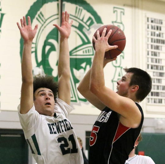 Nathan Mack of Spencer-Van Etten goes up for a shot as LaRon Boykin of Newfield defends in an IAC South Small School boys basketball tiebreaker Feb. 13, 2019 at Newfield.