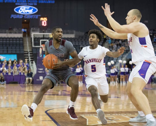 Missouri State's Josh Webster (0)  gets in position take a shot during the first half of the University of Evansville vs Missouri State game at the Ford Center in Evansville, Ind. Wednesday, Feb. 13, 2019.