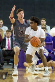 Missouri State's Ryan Kreklow (20) guards Evansville's Shamar Givance (5) as the Bears take on the Purple Aces at the Ford Center in Evansville, Ind. Wednesday, Feb. 13, 2019.