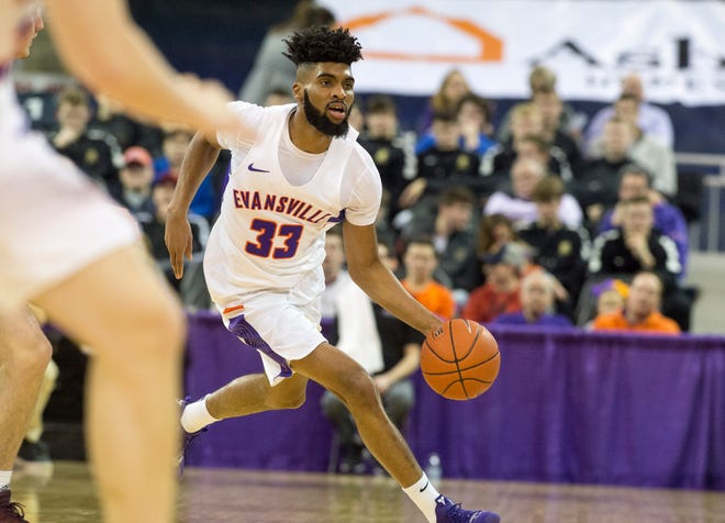 Evansville's K.J. Riley (33) dribbles the ball during the University of Evansville vs Missouri State game at the Ford Center in Evansville, Ind. Wednesday, Feb. 13, 2019.