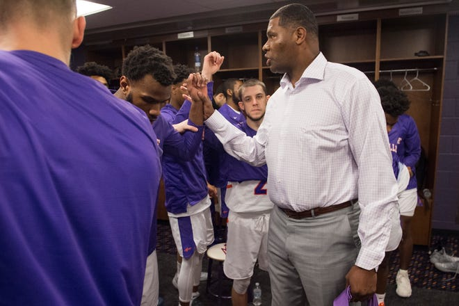 University of Evansville Head Coach Walter McCarty gathers with the Purple Aces Men's Basketball team in the locker room before University of Evansville vs Missouri State game at the Ford Center in Evansville, Ind. Wednesday, Feb. 13, 2019.