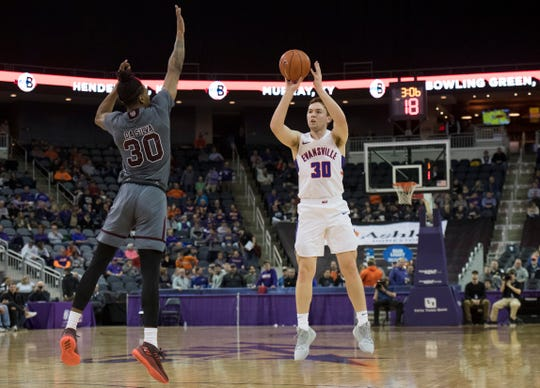 Evansville's Noah Frederking (30) takes a 3-point shot during the first half of the University of Evansville vs Missouri State game at the Ford Center in Evansville, Ind. Wednesday, Feb. 13, 2019.