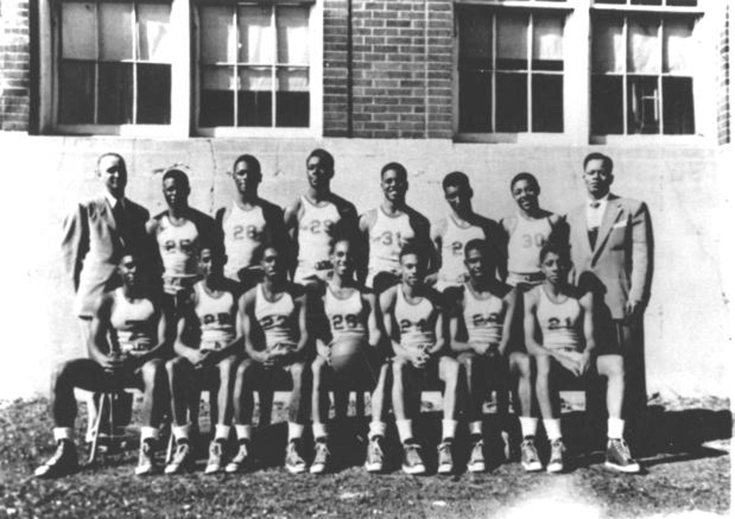 Lincoln High School basketball team, mid-1940s. The coach, Thomas Cheeks, whose Lions had always been a powerhouse in the state, regional, and and national competition among black high schools, is standing on the far left.