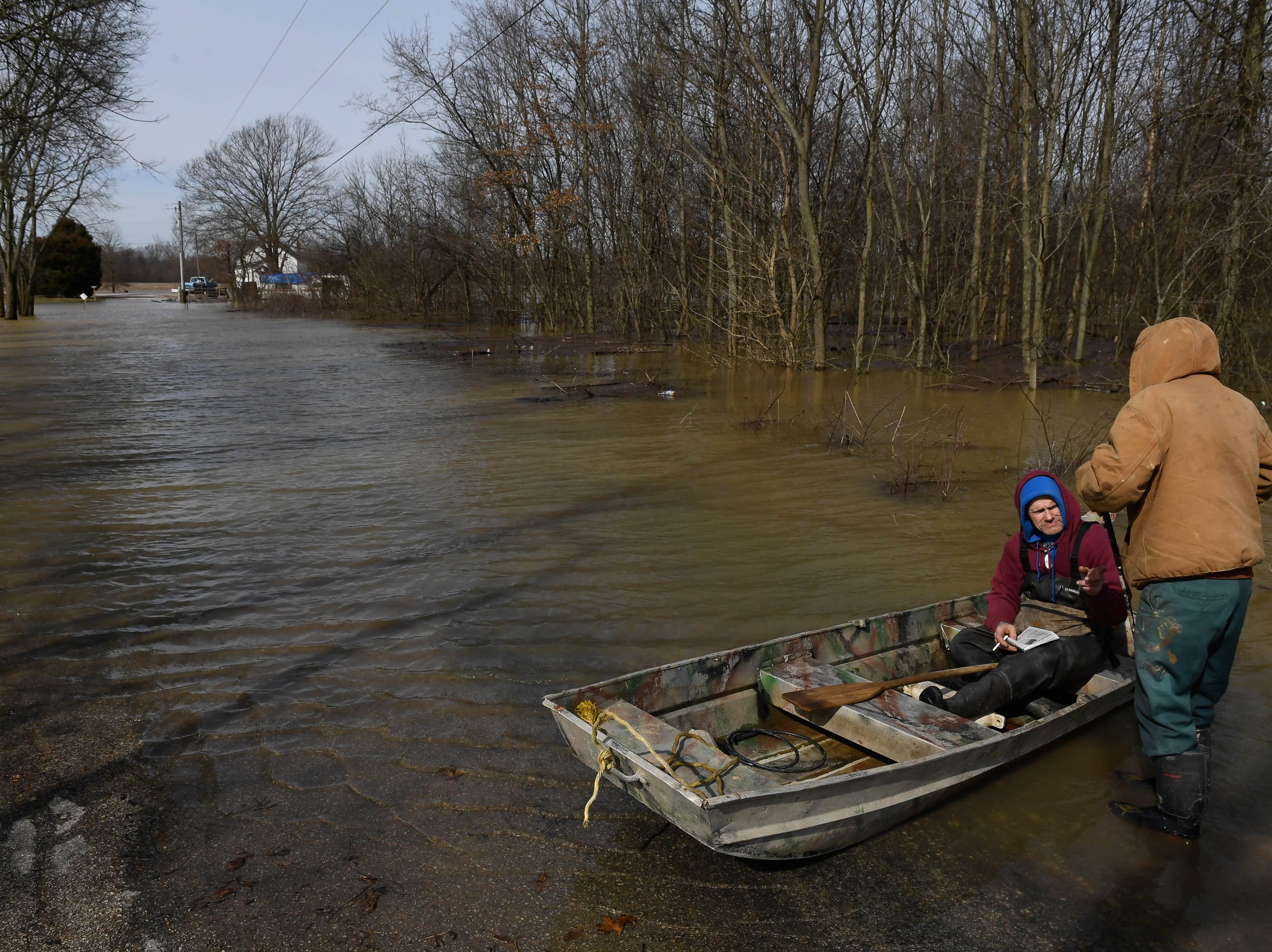 Beals resident uses a boat to travel to and from his home on West Pike Landing Road in eastern Henderson County Wednesday, February 13, 2019.
