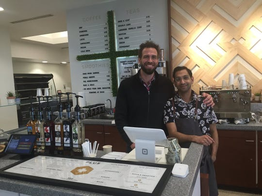 PLUS by Honey Moon has opened in the Old National Bank lobby. Zac Parsons (left) is the owner, and Omair Qadir is the manager.