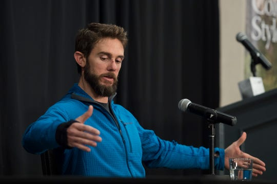 Local runner Travis Kauffman describes the approximate size of the adolescent mountain lion that attacked him, as seen on Thursday, Feb. 14, 2019, in Fort Collins, Colo.