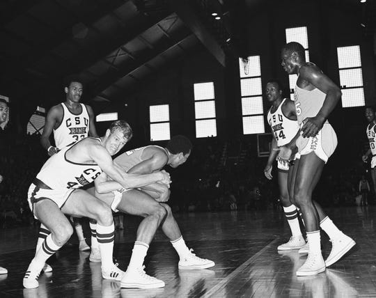 CSU's Mike Davis, left, tries to rip the ball away from Drake's Willie Wise during the NCAA Midwest Regional championship game March 15, 1969, in Manhattan, Kansas. CSU lost 84-77, denying the Rams a trip to the Final Four.