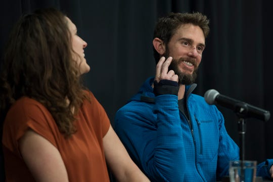 Local runner Travis Kauffman recounts how his girlfriend, Annie Bierbower, left, kiss him on the cheek after she met him at Poudre Valley Hospital after he was attacked by a adolescent mountain lion that attacked him, as seen on Thursday, Feb. 14, 2019, in Fort Collins, Colo.