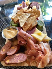 """The """"Hunter's Meat & Cheese Board"""" from Redfish Point in Cape Coral is a buffet of meats, cheeses and half-sour pickles."""